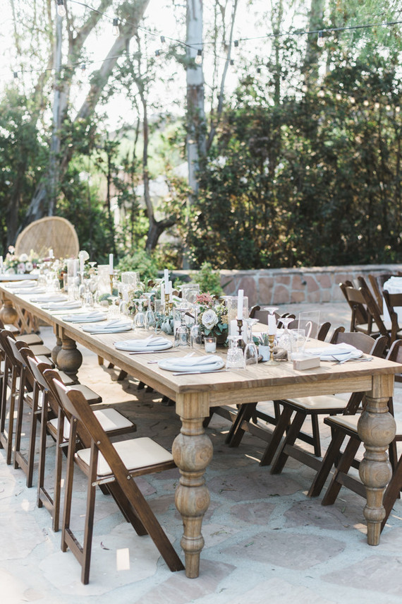 The wedding reception tables were uncovered but decorated with potted cacti, succulents and air plants