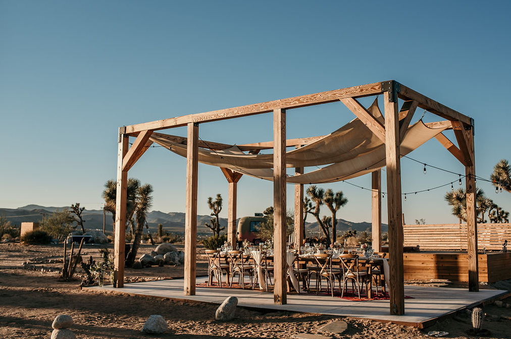 The wedding reception was placed on a platform with curtains over it