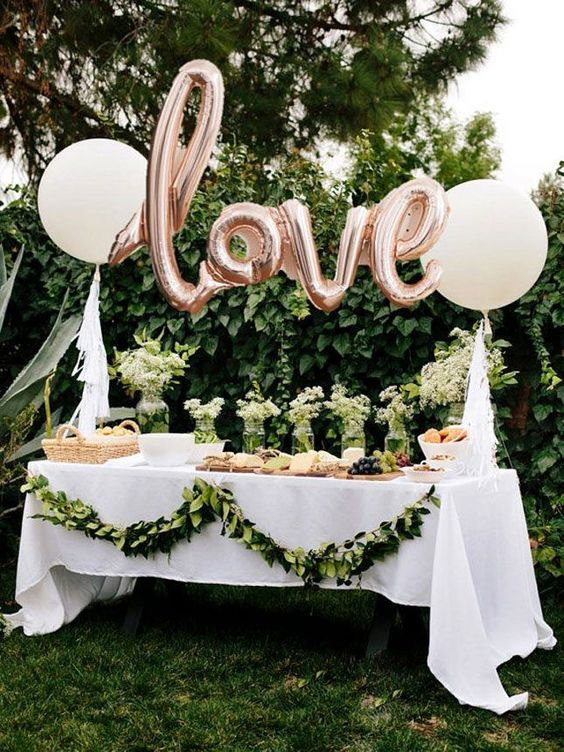a dessert table is a must for an outdoor bridal shower