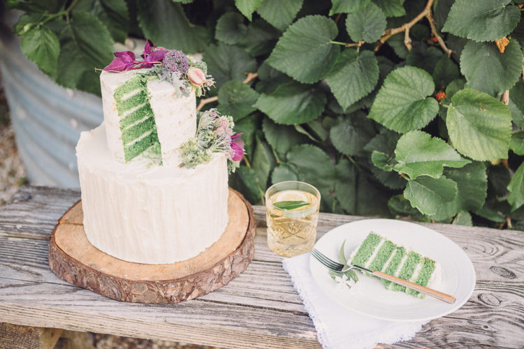 The wedding cake was a green layered sponge one with white frosting, topped with greenery and blooms