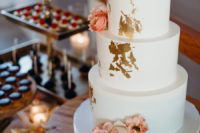 10 The wedding cake was a white one, with gold leaf and peachy pink blooms