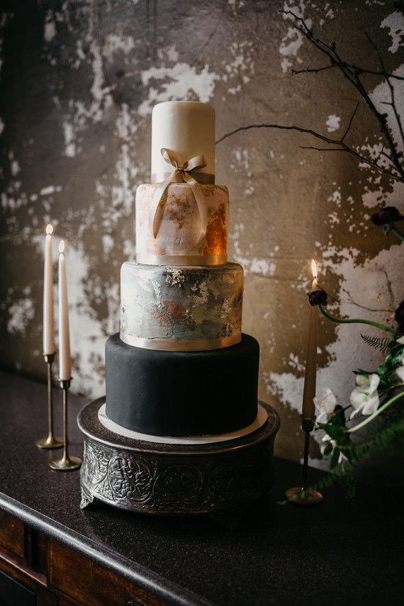 The wedding cake was done in white, black and with two abstract tiers with brushstrokes and a ribbon bow