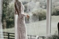 10 a gorgeous lace sheath wedding dress with a turtleneck and long sleeves plus a cutout back on buttons