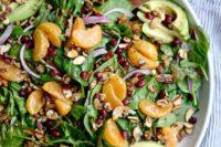 10 avocado and mandarins spring salad with greens, onios, garlic and a dressing of honey and mustard