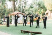 11 A mariachi band was playing musicc for the reception