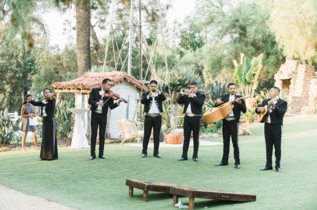 A mariachi band was playing musicc for the reception