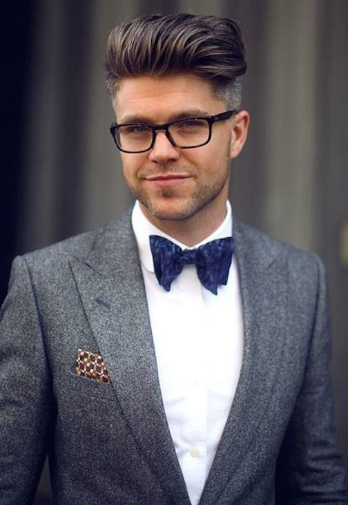 a dimensional and voluminous pompadour with a slight fade and glasses for a chic gent look