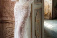 11 a gorgeous vintage-inspired lace sheath wedding dress with a turtleneck and puff slone sleeves plus a train