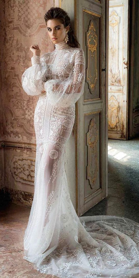 a gorgeous vintage-inspired lace sheath wedding dress with a turtleneck and puff slone sleeves plus a train