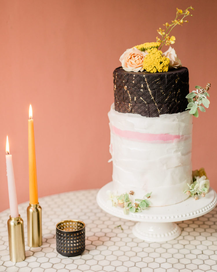 The wedding cake was textural and unique, with black and white parts and fresh blooms on top