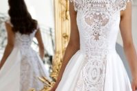 12 turtleneck A-line wedding dress with a plain full overskirt and cape sleeves for a more formal wedding