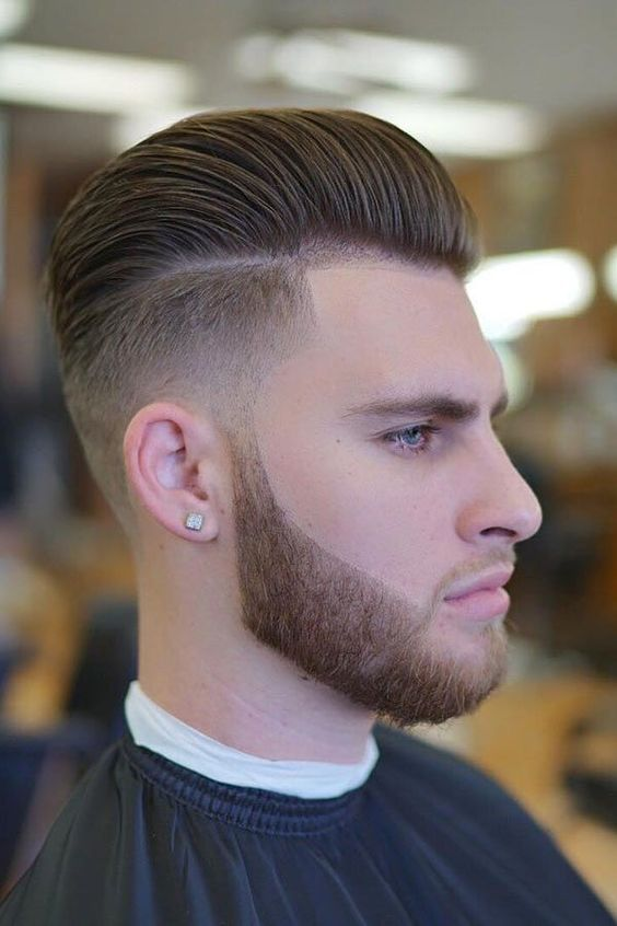 a mid fade taper cut with a beard is a bold and modern option that will add style to your look