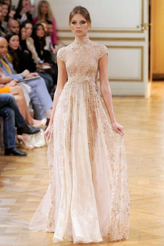 a nude lace wedding gown with cap sleeves and a turtleneck plus an illusion bodice for a daring bride