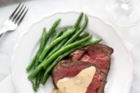14 beef tenderloin with cognac cream sauce, shallots and thyme and fresh asparagus as a garnish