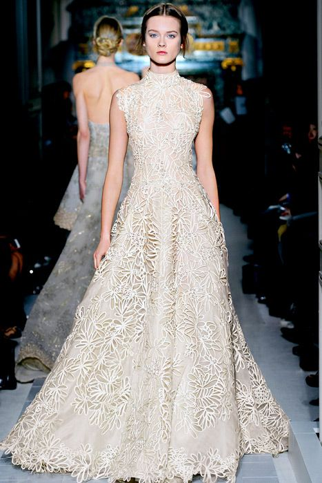 a textural floral wedding gown with a turtleneck, an A-line skirt by Valentino is a gorgeous idea