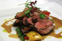 15 chargrilled lamb with fresh sprign veggies and herbs on top is a cool idea for a spring wedding