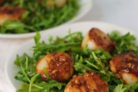 16 sea scallops over arugula with white wine garlic sauce is a fresh and not too hearty main course