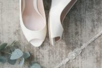 16 white lace peep toe wedges are ideal for a minimalist bride and will bring much comfort