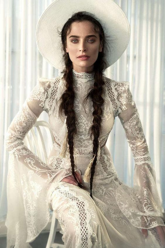 a turtleneck sheath boho lace wedding dress with long sleeves and a matching hat for a gypsy bride