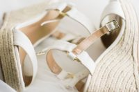 18 white and tan strappy wedges with wicker platforms are a comfy and casual shoe option