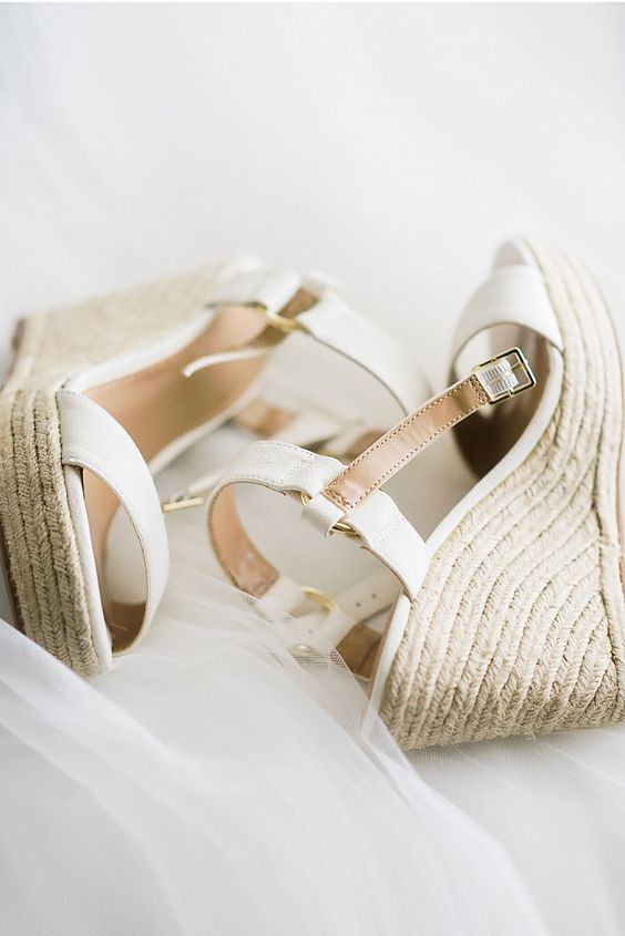 white and tan strappy wedges with wicker platforms are a comfy and casual shoe option