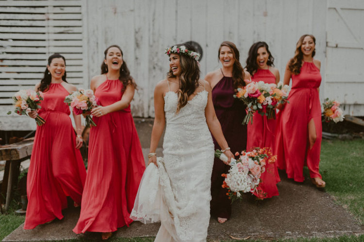 pink maxi bridesmaid dresses with halter necklines and front slits and a burgundy halter neckline maxi dress for the maid of honor
