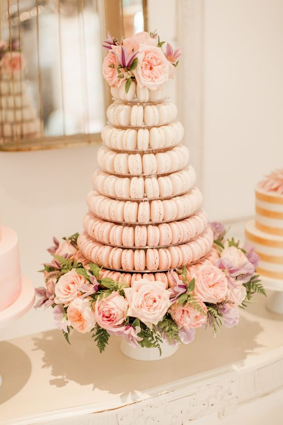 a delicate ombre macaron tower in blush with fresh blush blooms for decor