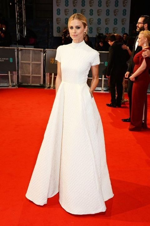 a textural turtleneck wedding gown with short sleeves and a full skirt with pockets is a chic idea for a modern bride