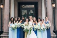 22 cobalt and light blue plus navy maxi gowns for the bridesmaids and a gold sequin one shoulder maxi dress for the maid of honor