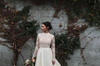 23 a chic bridal separate with a lace top with long sleeves and a turtleneck plus a plain high low skirt with a train
