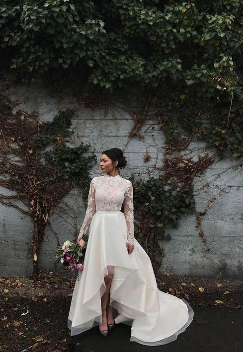 a chic bridal separate with a lace top with long sleeves and a turtleneck plus a plain high low skirt with a train