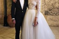 24 a chic wedding separate with a crochet lace top with long sleeves and a turtleneck plus a tulle skirt
