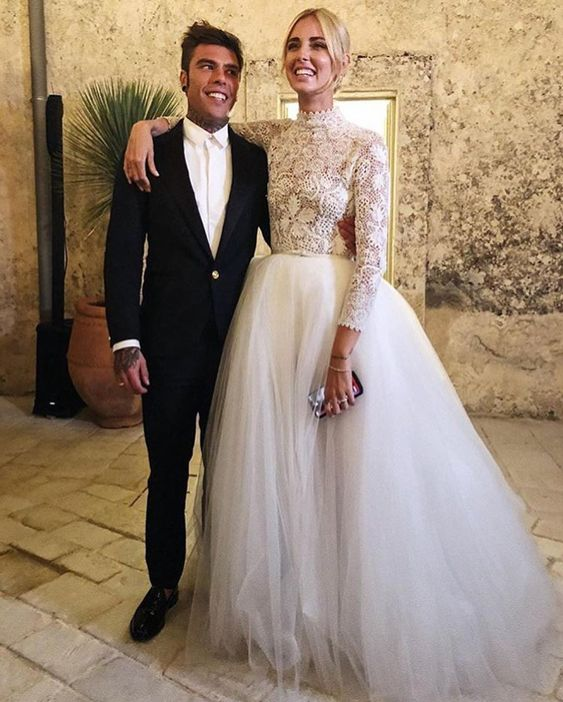 a chic wedding separate with a crochet lace top with long sleeves and a turtleneck plus a tulle skirt