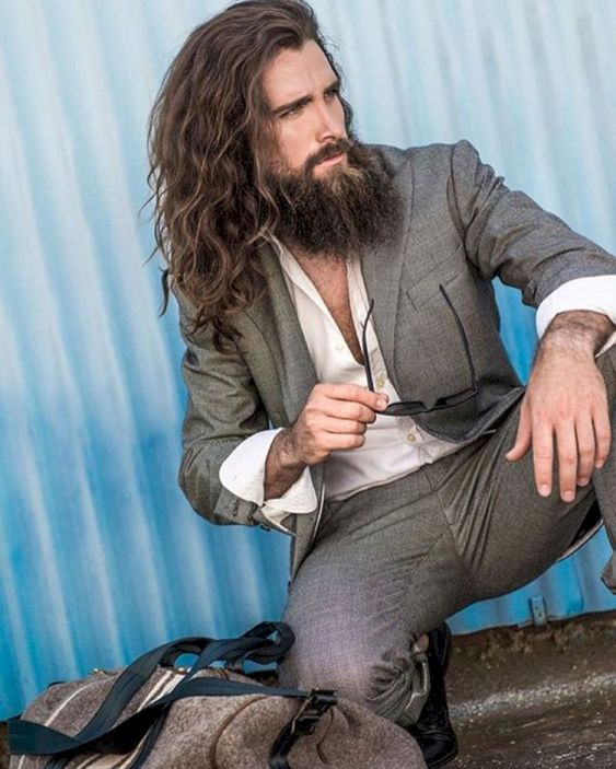 long wavy hair and a beard for a relaxed and boho chic look, a great idea for a hipster groom