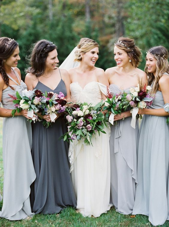 mismatching dove grey maxi gowns with ruffled edges and a charcoal grey spaghetti strap one for the maid of honor