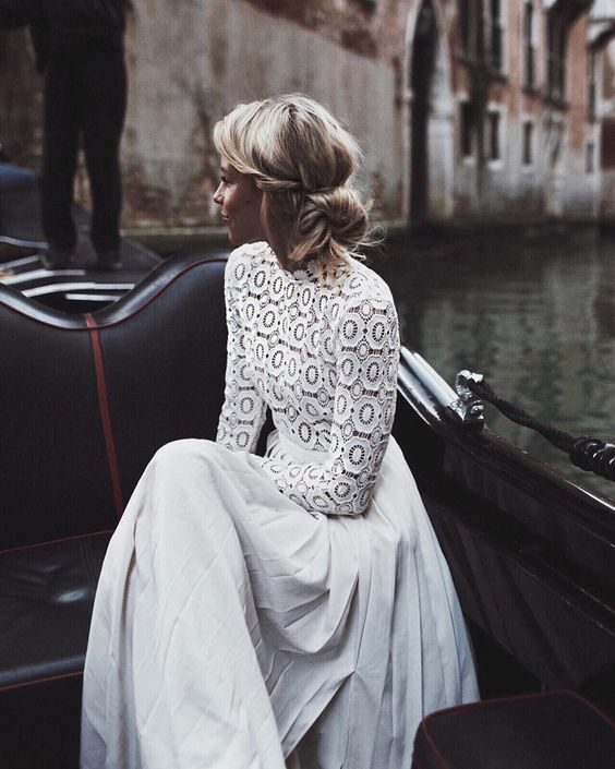a modern wedding separate with a crochet lace top with a turtleneck and long sleeves and a pleated maxi skirt