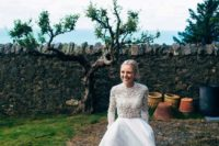 26 a modern wedding separate with a lace embellished turtleneck top and a plin full skirt with a front slit and a train