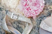 26 sparkling strappy wedges in silver with polished metal heels is a chic and glam idea