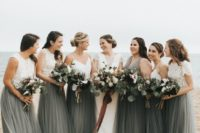 26 white lace crop tops and dark green maxi skirts for the bridesmaids and a dark green maxi gown for the maid of honor