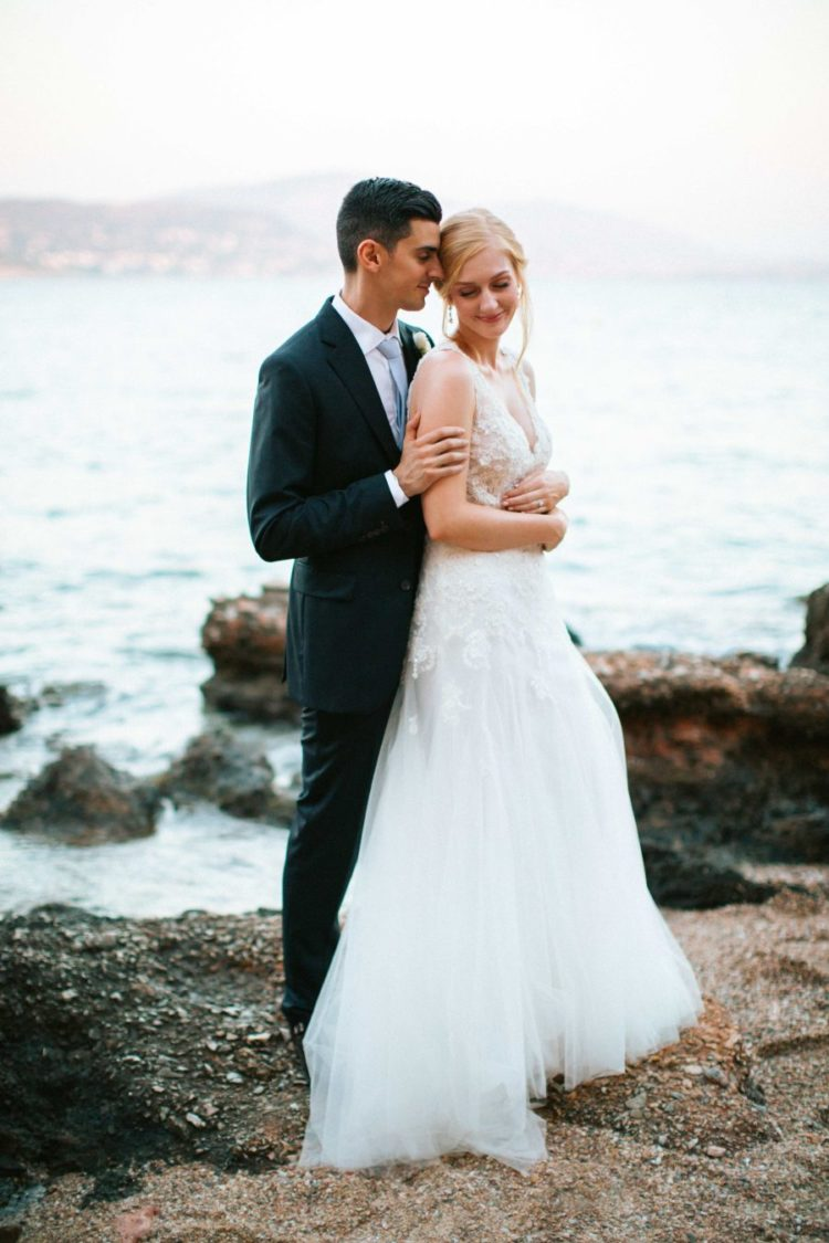 This couple went for a romantic neutral wedding in Greece as the groom proposed in this country and as they both like it very much