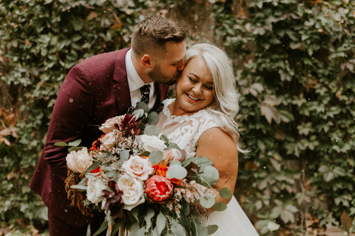 This fall wedding was full of beautiful florals, touches of rustic decor and featured a modern reception