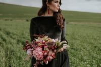 02 The bride was rocking gorgeous locks down, a black wedding gown with a high neckline, an orchid headpiece and a striking bouquet