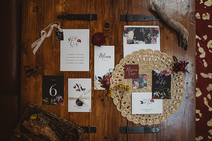 The wedding invitation suite was done in black and white with moody florals printed