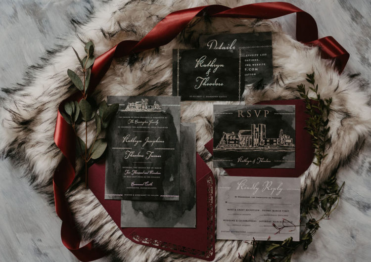 The wedding invitation suite was done with dark watercolor and a castle
