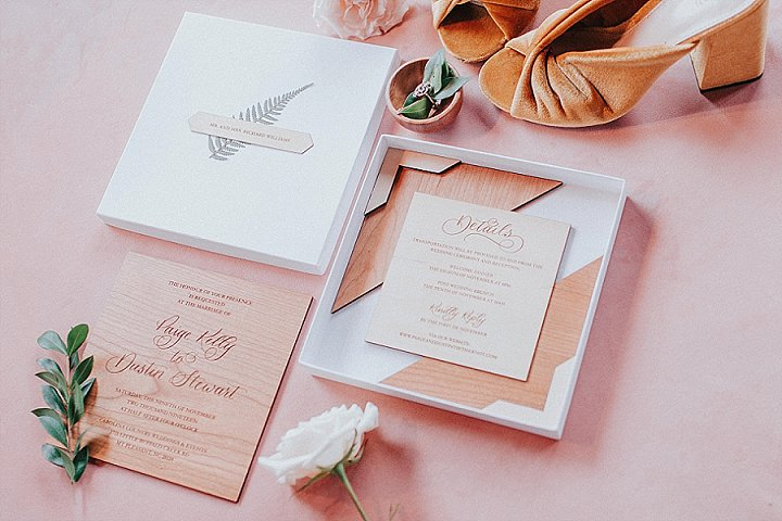 The wedding stationery suite was done with wood and plywood, with elegant calligraphy and boxes instead of envelopes