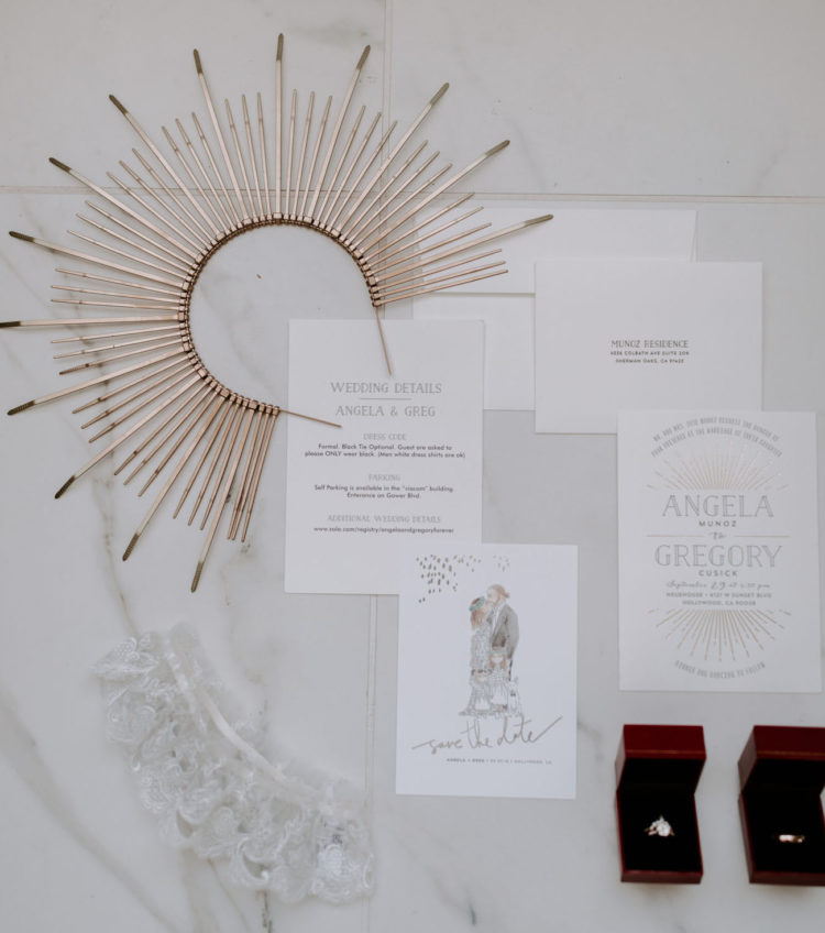 The wedding was spruced up with sunburst motifs - the headpiece, the backdrop and the stationery were done with them