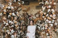 02 a jaw-dropping wedding installation with dried herbs and white and blush blooms for a beautiful fall wedding