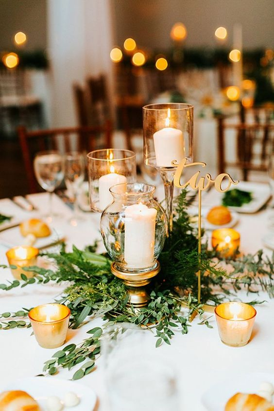 bring some cool candle holders you like to your reception to decorate the tables or make centerpieces