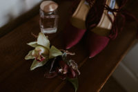 03 Her shoes were burgundy to match the blooms and her lipstick
