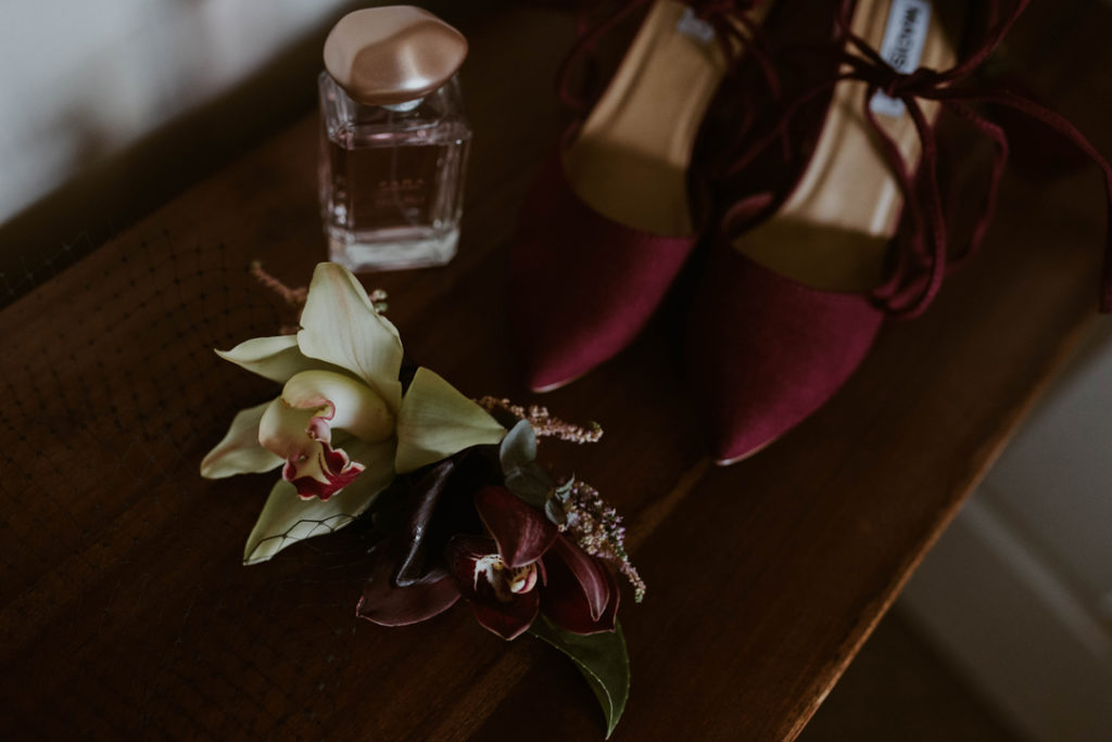 Her shoes were burgundy to match the blooms and her lipstick